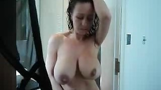 Epic MILF with huge boobs caught in the showe
