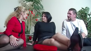 Stocking-clad granny with huge tits enjoying a hardcore threesome