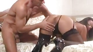 Big butt Latina in stockings gives a BJ
