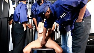Dark-haired MILF gets her hairy pussy gangbanged in the prison